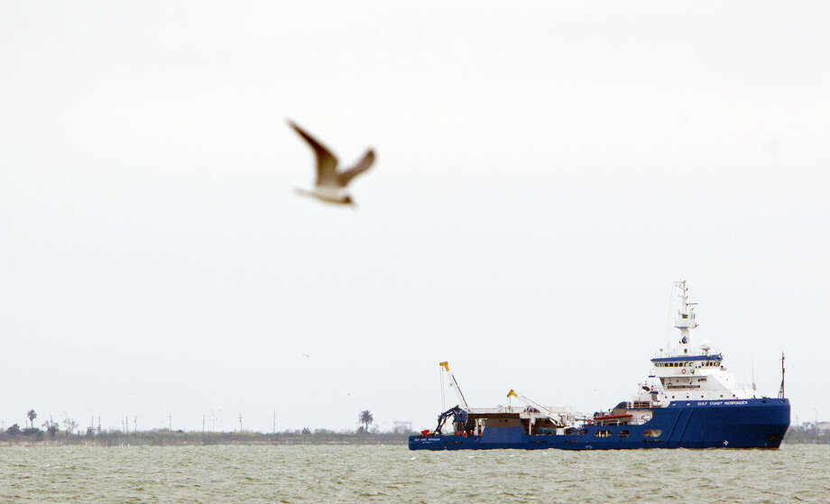 A Gulf Coast Responder ship makes its way off the shore along Boddeker Rd. on the Eastern end of Galveston, Monday, March 24, 2014, in Galveston. Oil washed ashore after a barge carrying heavy oil collided with a ship Saturday in the busy Houston Ship Channel. Photo: Cody Duty, Houston Chronicle / © 2014 Houston Chronicle
