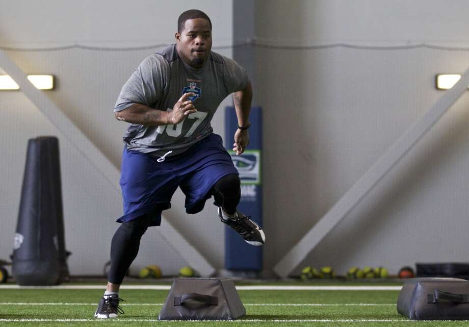 Montana-Western defensive tackle Saul Collins high steps over a pad Saturday, March 22, 2014, during position drills at an NFL football regional combine in Renton, Wash. (AP Photo/Stephen Brashear) Photo: AP