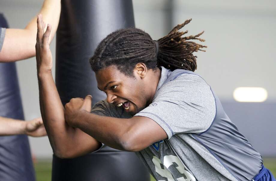 Benthune-Cookman linebacker Branden Bryant rushes past a tackling dummy Saturday, March 22, 2014, during position drills at an NFL football regional combine in Renton, Wash. (AP Photo/Stephen Brashear) Photo: AP