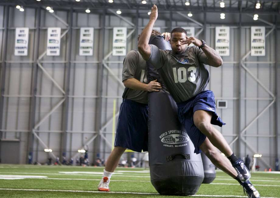 Trinity Valley Community College defensive lineman Jeremiah Thomas participates in position drills Saturday, March 22, 2014, during an NFL football regional combine in Renton, Wash. (AP Photo/Stephen Brashear) Photo: AP