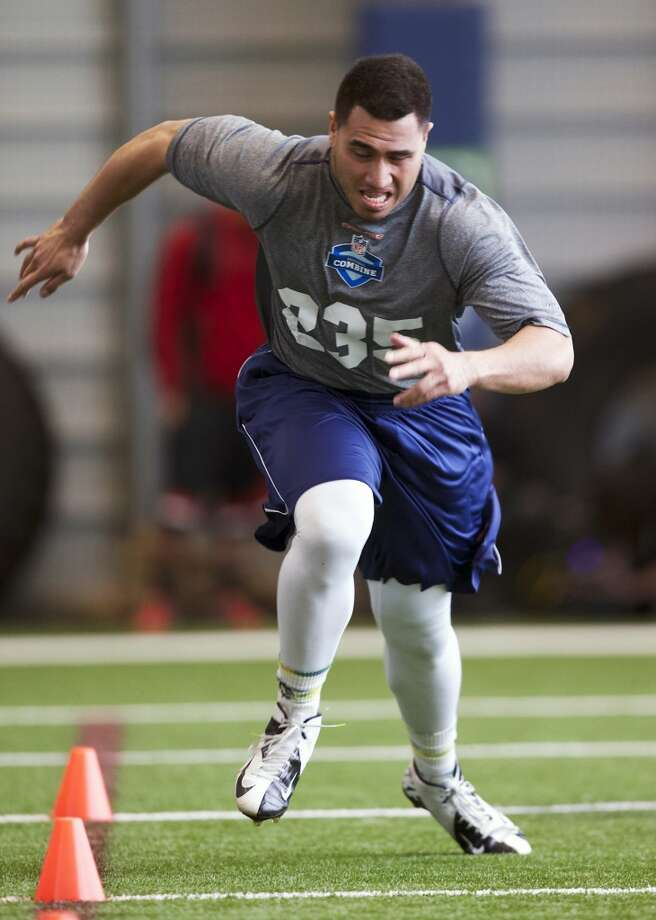BYU running back Harvey Unga runs to the finish of the short shuttle drill Saturday, March 22, 2014, during practice drills at an NFL football regional combine in Renton, Wash. (AP Photo/Stephen Brashear) Photo: AP