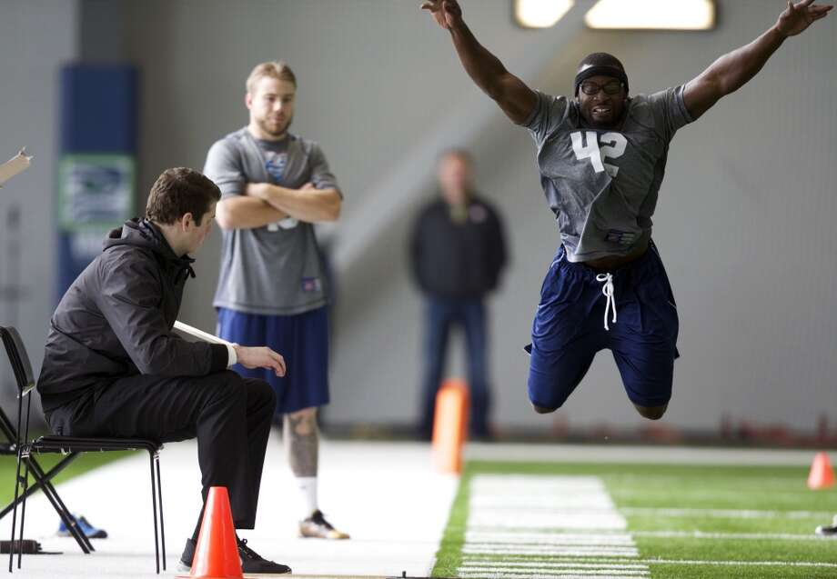 Utah State defensive back Paul Igboeli jumps Saturday, March 22, 2014, during practice drills at an NFL football regional combine in Renton, Wash. (AP Photo/Stephen Brashear) Photo: AP