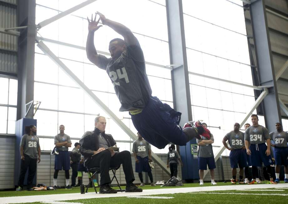 Jovon Mclaughlin jumps Saturday, March 22, 2014, during practice drills at an NFL football regional combine in Renton, Wash. (AP Photo/Stephen Brashear) Photo: AP