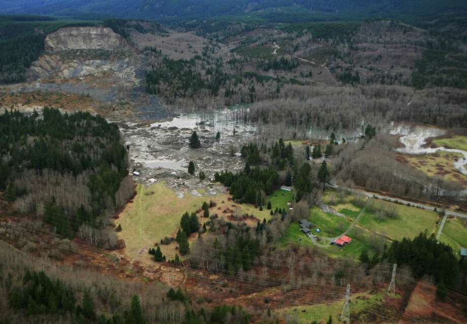 This Sunday photo, made available by the Washington State Dept of Transportation, shows a view of the damage from Saturday's mudslide near Oso. Photo: Uncredited, Associated Press / AP2014