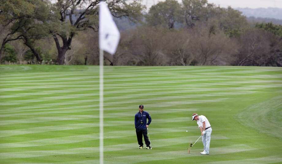 John Petterson of Ft. Worth, TX, hits his approach shot on the par 5 8th hole during The Bay Ltd. Pro-Am at the 2014 Valero Texas Open on the TPC San Antonio AT&T Oaks Course. Monday, March 24, 2014. Photo: Bob Owen, San Antonio Express-News / ©2013 San Antonio Express-News