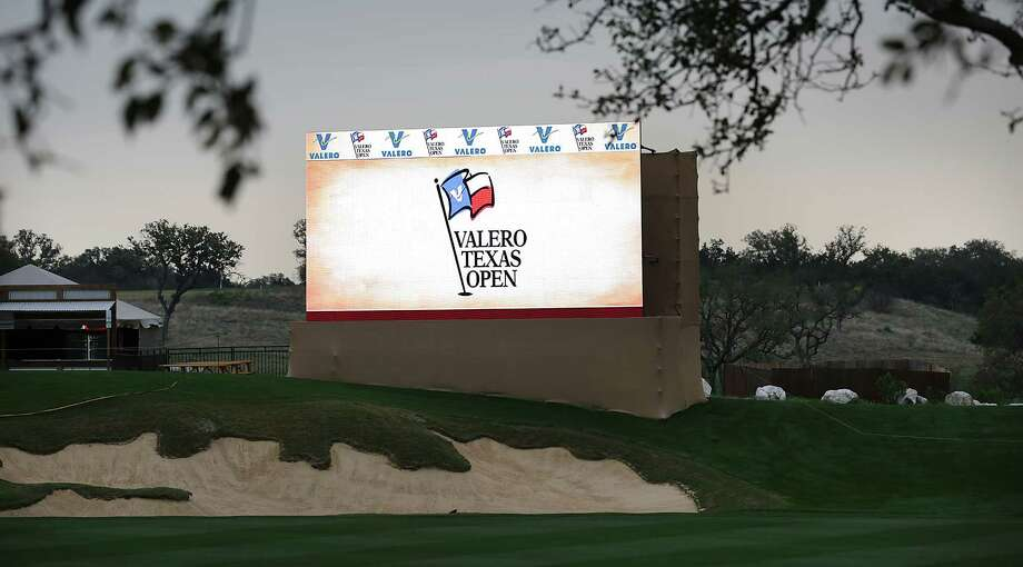 A score board shines bright as dark skies hault play of The Bay Ltd. Pro-Am at the 2014 Valero Texas Open on the TPC San Antonio AT&T Oaks Course. Monday, March 24, 2014. Photo: Bob Owen, San Antonio Express-News / ©2013 San Antonio Express-News