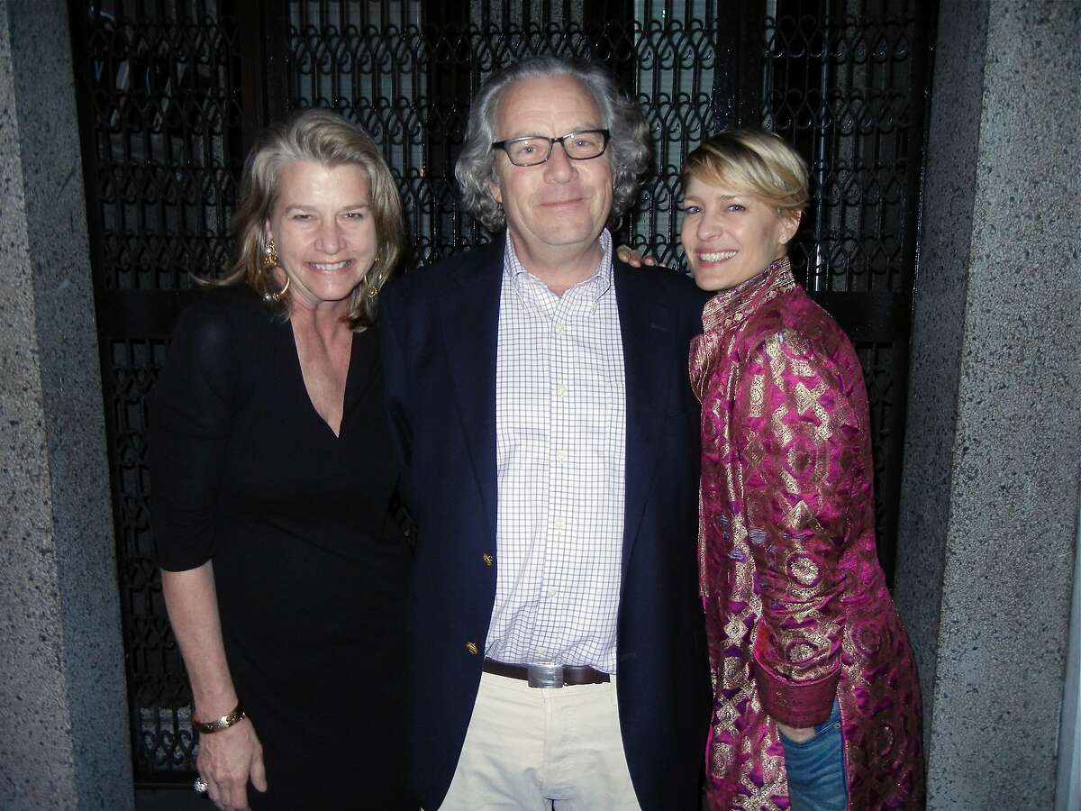 Margaret Youngblood Allen (left) with her husband, Peter Allen, and actress Robin Wright, in North Beach for her husband's 60th birthday. March 2014. By Catherine Bigelow.