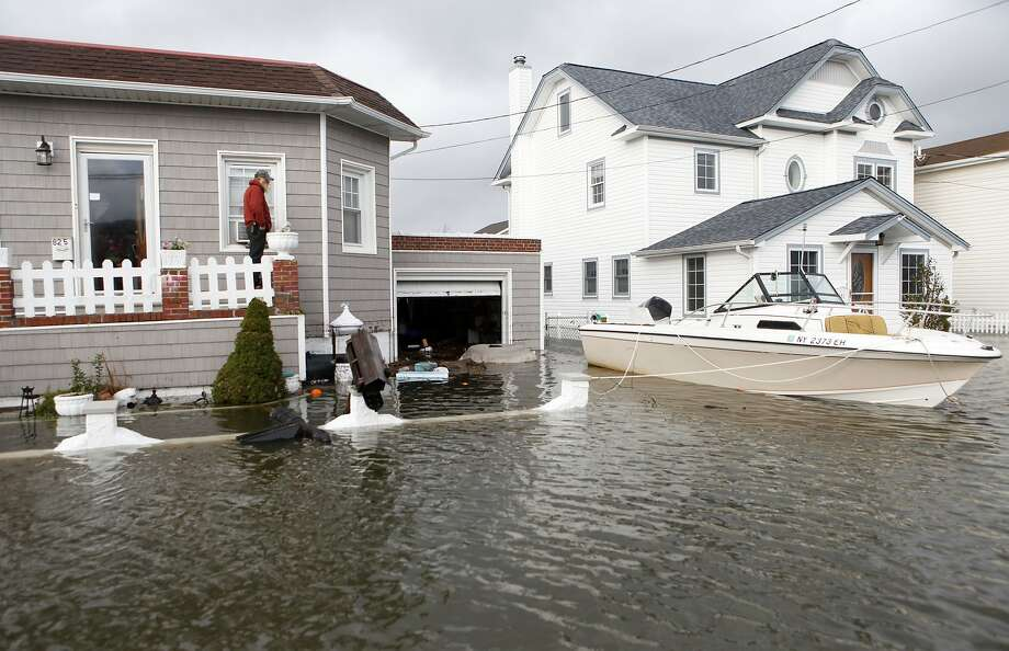 A neighborhood is flooded in the aftermath of Superstorm Sandy in Lindenhurst, N.Y., in 2012. Photo: Jason DeCrow, Associated Press
