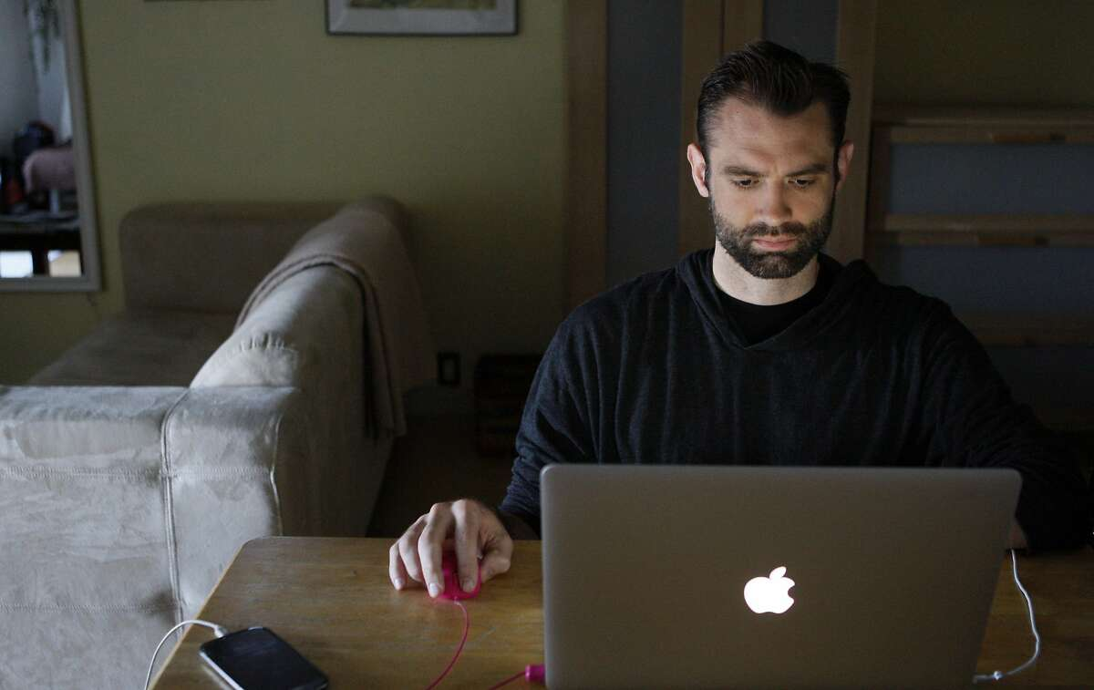 Noah Dyer sits at his computer on his last day staying in an Airbnb studio in Bernal Heights on March 21, 2014 in San Francisco, Calif. Airbnb allowed Dyer and Nick Vaden (not pictured) who came to San Francisco for the Game Developers Conference from the University of Advancing Technology in Arizona to save over $300 on their $1200 travel budget.