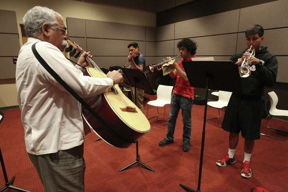 Palo Alto College plans to create the Juan Ortiz Mariachi Academy, named for Campanas de Americas founder, two-time Grammy winner and Palo Alto full-time instructor Juan Ortiz (left). Photo: Kin Man Hui / San Antonio Express-News / ©2013 San Antonio Express-News