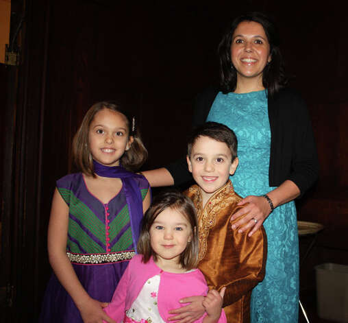 From left, Lila, Coral, Liam and Dawn Padfield of Albany are among the local Baha'is celebrating Naw-Ruz, the new year, at a ceremony at the Emma Willard  School in Troy on Thursday. (Paul Murray)