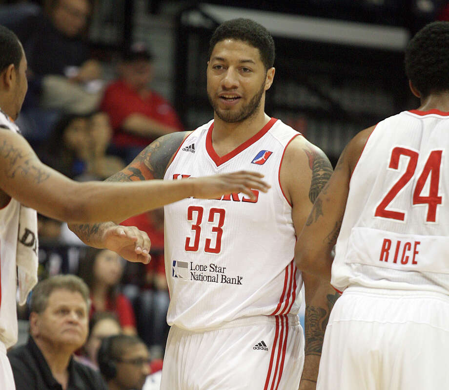 Rio Grande Valley Vipers' Royce White (33) high-fives his teammates during a timeout against the Maine Red Claws in a basketball game Tuesday, Feb. 12, 2013, in Hidalgo, Texas. White scored seven points, grabbed eight rebounds and had four assists for the Vipers in their 139-122 win over Maine, one day after reporting to the Houston Rockets' developmental league affiliate. He had been away from the Rockets since early November after requesting an arrangement to help him properly treat his diagnosed anxiety disorder while balancing the demands of the NBA schedule. (AP Photo/The Monitor, Joel Martinez) MAGS OUT  TV OUT Photo: Joel Martinez, Associated Press / The Monitor