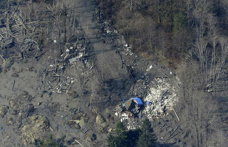 """A house near Arlington, Wash., was destroyed by the massive mudslide that killed at least 14 people and left several dozen missing. """"The situation is very grim,"""" says a firefighter. Photo: Ted S. Warren / Associated Press / AP"""