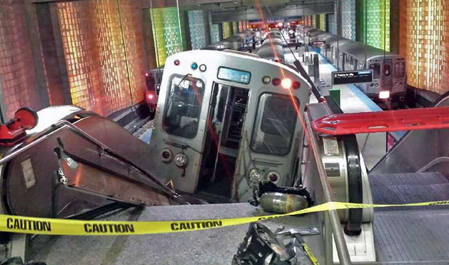 A Chicago Transit Authority train car rests on an escalator at the O'Hare Airport station after it derailed early Monday. Photo: Associated Press / NBC Chicago