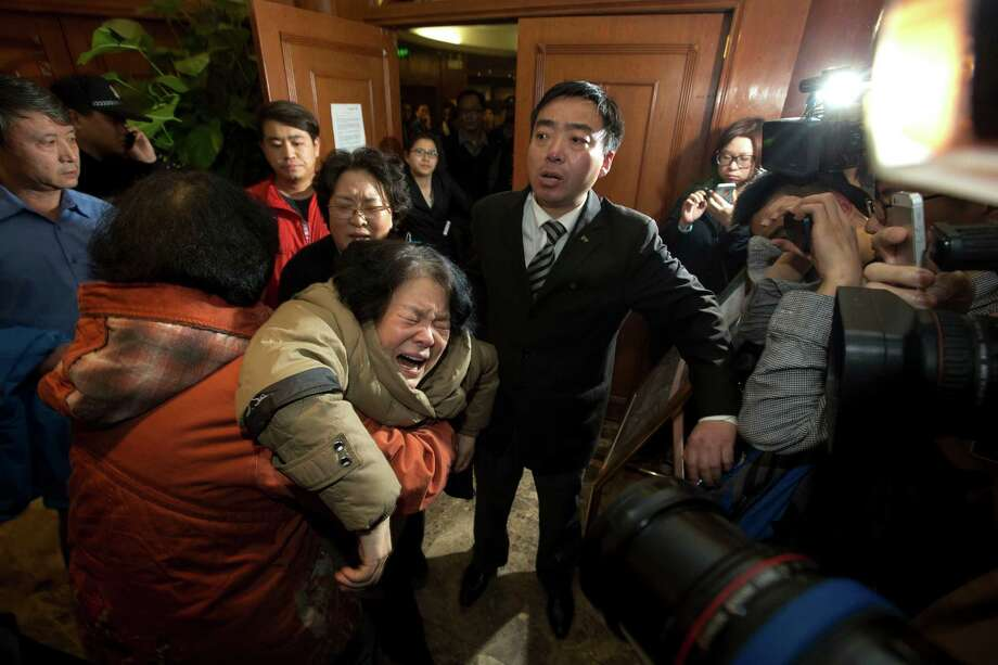 A relative of one of the Chinese passengers aboard the Malaysia Airlines, MH370 collapses in grief after being told of the latest news in Beijing, China, Monday, March 24, 2014. It was the grim news that families of the missing Malaysian Airlines flight had dreaded for weeks, and on Monday they heard it from Malaysia's prime minister: new analysis of satellite data indicates the missing plane crashed into a remote corner of the Indian Ocean. (AP Photo/Ng Han Guan) Photo: Ng Han Guan, STF / AP
