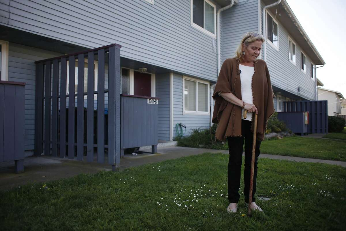 Treasure Island resident Kathryn Lundgren stands in front of her home on Treasure Island on Monday, March 24, 2014, on Treasure Island in San Francisco, Calif. A group of Navy contractors dug a small radioactive fragment out of her front yard in January 2014.