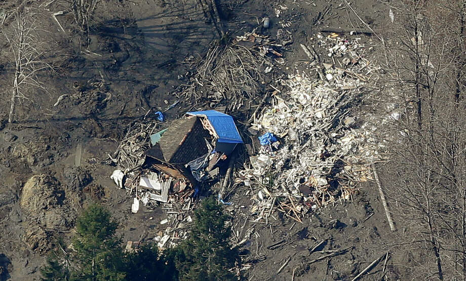 A massive mudslide destroyed about 30 homes near Arlington, Wash., after striking Saturday morning. Dozens of residents are still not accounted for. Photo: Ted S. Warren, STF / AP