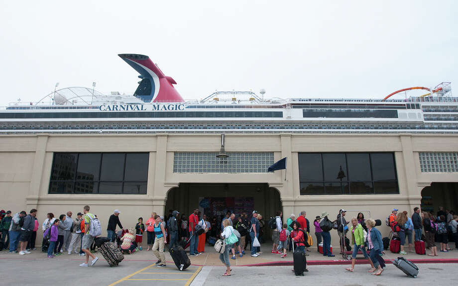 Passengers wait to board a Carnival Magic cruise ship at the Port of Galveston on  Monday. The departure was delayed after a barge carrying heavy oil collided with a ship Saturday, closing the busy Houston Ship Channel to traffic as cleanup efforts continue. Photo: Cody Duty, Staff / © 2014 Houston Chronicle