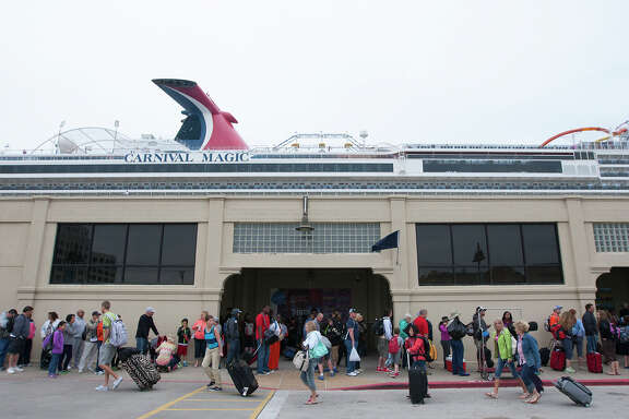 Passengers wait to board a Carnival Magic cruise ship at the Port of Galveston on  Monday. The departure was delayed after a barge carrying heavy oil collided with a ship Saturday, closing the busy Houston Ship Channel to traffic as cleanup efforts continue.