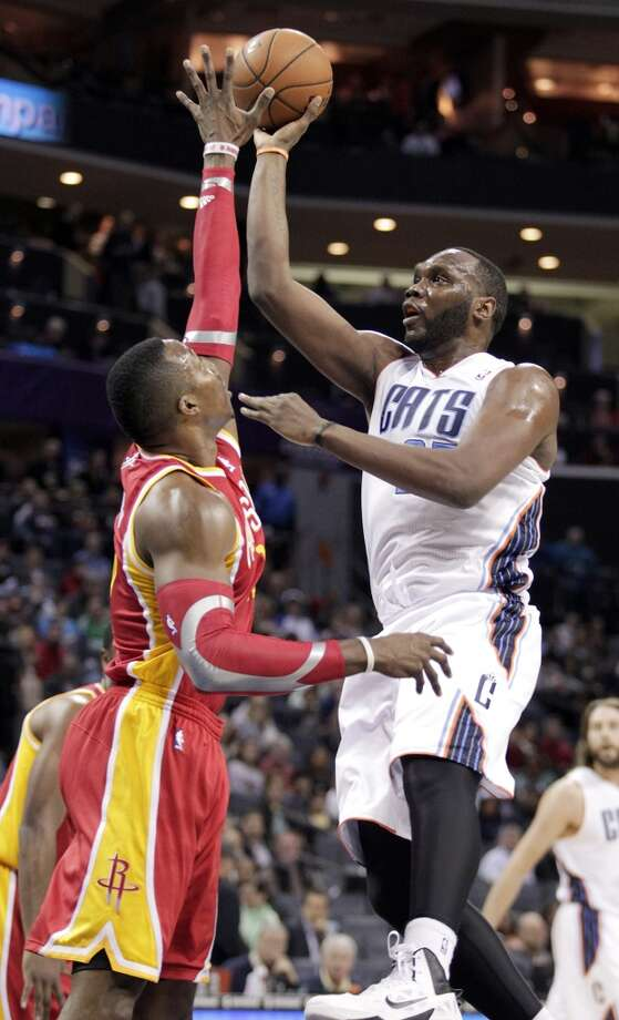 March 24: Rockets 100, Bobcats 89  Rockets center Dwight Howard contests a shot by Al Jefferson of the Bobcats. Photo: Bob Leverone, Associated Press