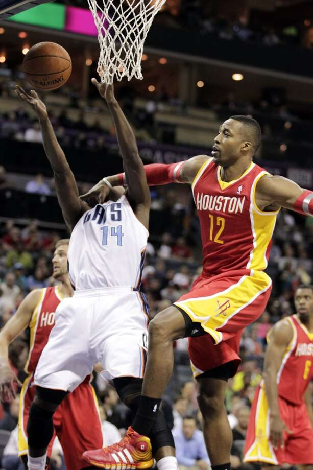 Rockets center Dwight Howard makes contact with Michael Kidd-Gilchrist of the Bobcats. Photo: Bob Leverone, Associated Press