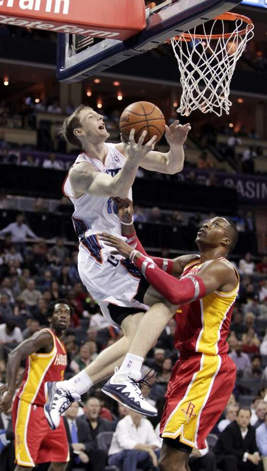 Bobcats center Cody Zeller attempts a shot against Dwight Howard of the Rockets. Photo: Bob Leverone, Associated Press