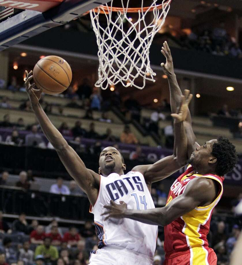 Michael Kidd-Gilchrist of the Bobcats attempts a shot against Pat Beverley of the Rockets. Photo: Bob Leverone, Associated Press