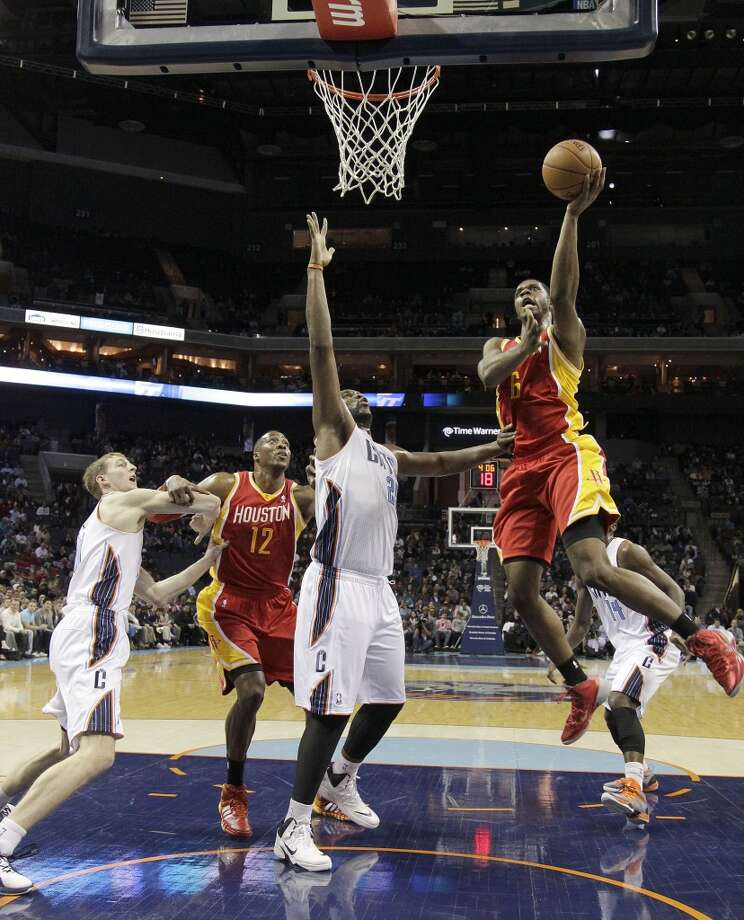 Rockets forward Terrence Jones drives to the basket against the Bobcats. Photo: Bob Leverone, Associated Press