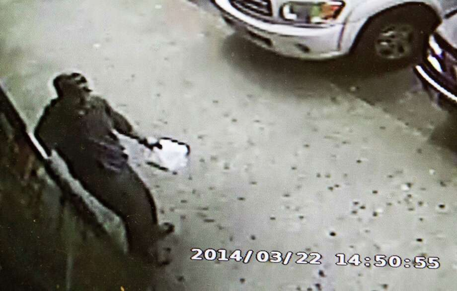 A surveillance video shows a man suspected in the death of a strip club worker leaving a game room before entering the Eclipse Gentlemen's Club in the 6800 block of South Gessner on Saturday. Photo: J. Patric Schneider, Freelance / © 2014 Houston Chronicle