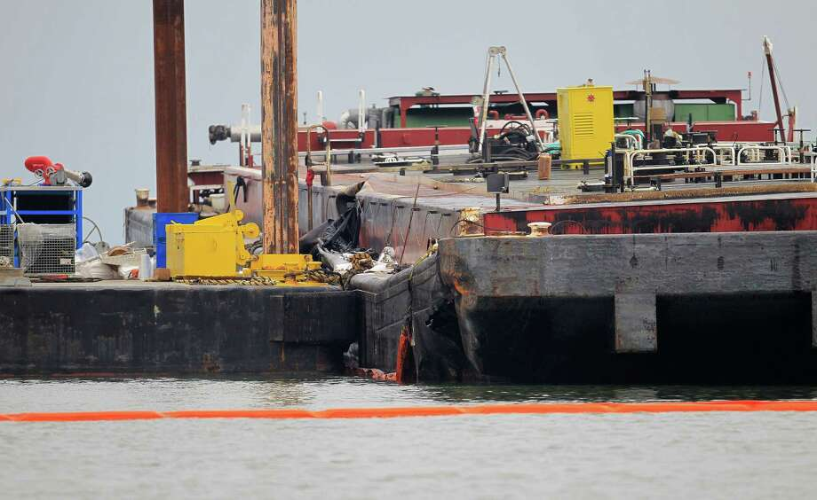 The wrecked barge that leaked fuel into the Houston Ship Channel, Saturday, just off of the Texas City dike Monday, March 24, 2014, in Texas City.  ( Karen Warren / Houston Chronicle  ) Photo: Karen Warren, Staff / © 2014 Houston Chronicle