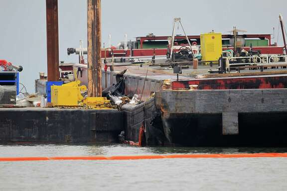 The wrecked barge that leaked fuel into the Houston Ship Channel, Saturday, just off of the Texas City dike Monday, March 24, 2014, in Texas City.  ( Karen Warren / Houston Chronicle  )