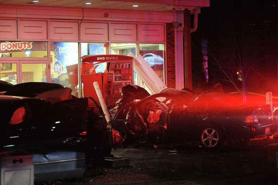 A Nissan Maxima is crushed against a safety pillar and a Redbox dvd rental machine after striking six cars at the Cumberland Farms gas station at 975 King's Highway East in Fairfield, Conn. on Monday, March 24, 2014. Police said the car crashed into the station, which is at the bottom of I-95 exit 24 southbound, at a high rate of speed after exiting the highway. Photo: Brian A. Pounds / Connecticut Post