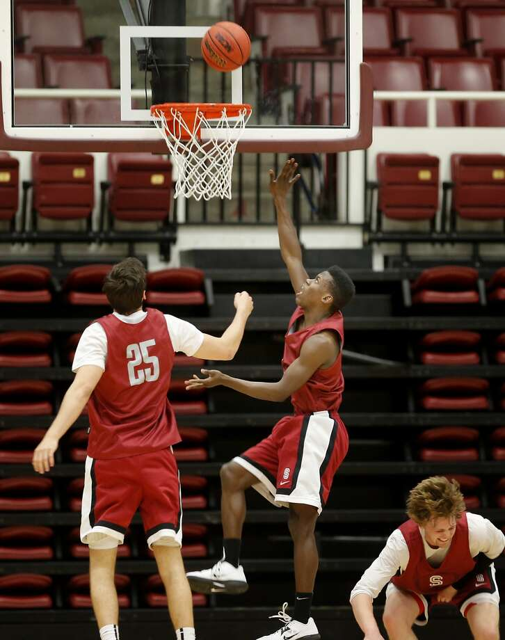Stanford's Malcolm Allen (3) went up for a basket as Rosco Allen (25) watched Monday March 24, 2014.  The Stanford mens basketball team returned to campus and held a short practice after defeating Kansas in an NCAA tournament game. Photo: Brant Ward, The Chronicle