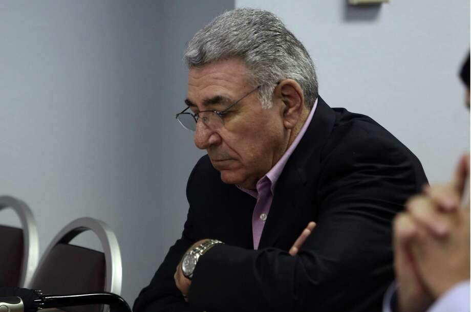 Dean Danos, the Alamo Area Council of Governments' executive director, listens as the AACOG's executive committee recommends to the full board in a unanimous vote to terminate Danos and Deputy Director Mike Quinn (inset), who have been on paid administrative leave since last month. Photo: Helen L. Montoya / San Antonio Express-News / SAN ANTONIO EXPRESS-NEWS