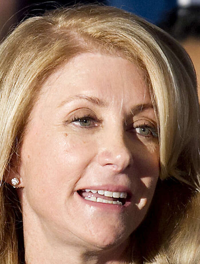 Wendy Davis defended her law firm's work on bonds for Dallas/Fort Worth Airport and the Tarrant Regional Water District. / Austin American-Statesman