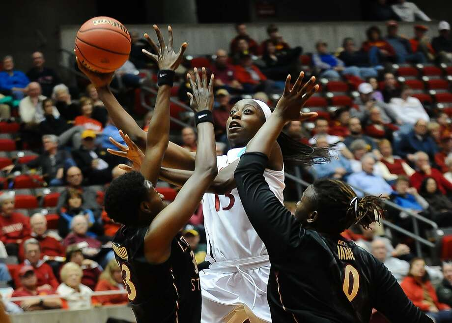 Chiney Ogwumike, who led Stanford with 21 points, shoots over the outstretched arms of Florida State defenders. Photo: Steven Branscombe, Reuters