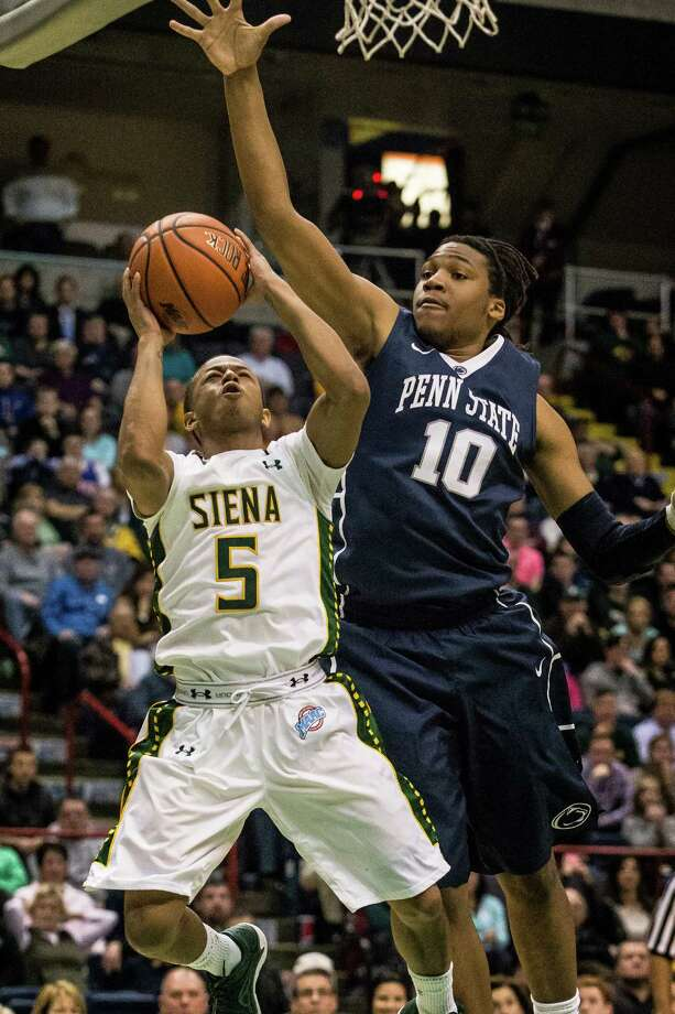 Siena's Evan Hymes, 5, goes up for the game winning shot against Penn State's Brandon Taylor, 10, during the College Basketball Invitational quarterfinal game at the Times Union Center, Monday, March 24, 2014 in Albany, N.Y.  Siena won over Penn State 54-52. (Dan Little/Special to the Times Union) Photo: Dan Little / Dan Little