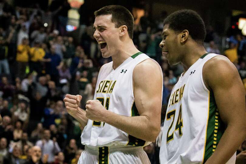Siena's Brett Bisping, left, and Lavon Long celebrate the men's basketball 54-52 win over Penn State