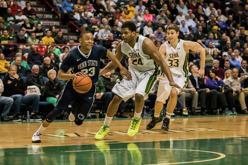 Siena's Lavon Long, 24, and Rob Poole, 33, defend against Penn State's Tim Frazier, 23, during the C