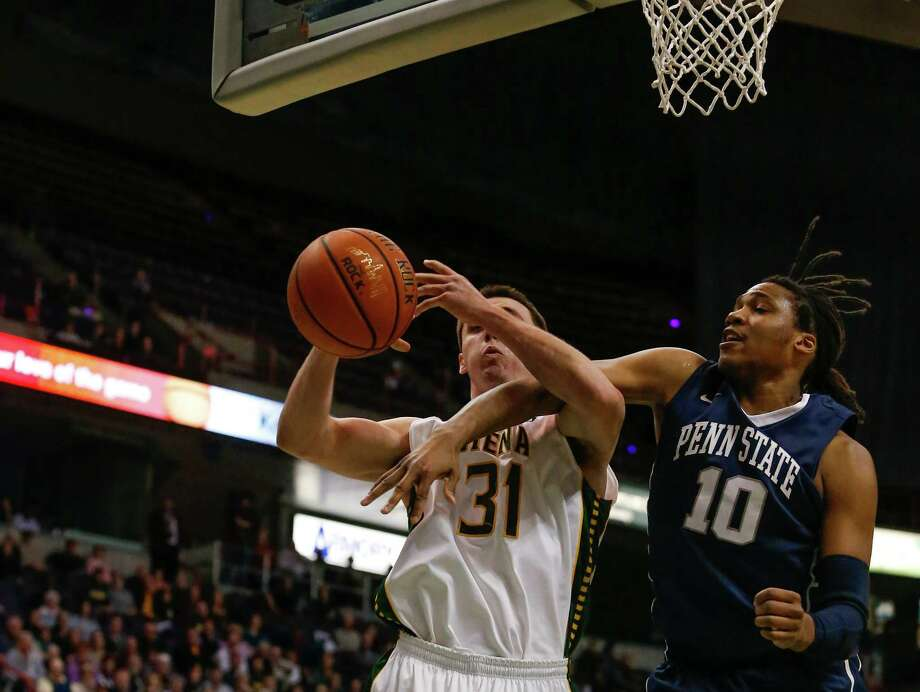 Penn State's Brandon Taylor, 10, gets an arm on Siena's Brett Bisping, 31, as he attempts to go up for a shot during the College Basketball Invitational quarterfinal game at the Times Union Center, Monday, March 24, 2014 in Albany, N.Y.  Siena won over Penn State 54-52. (Dan Little/Special to the Times Union) Photo: Dan Little / Dan Little