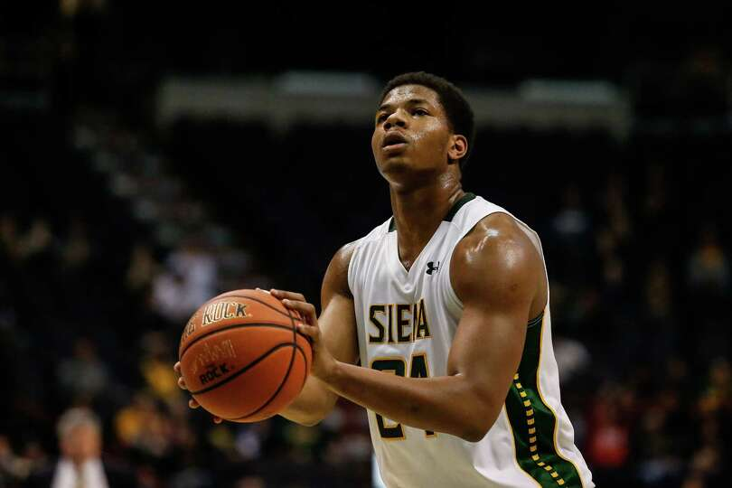 Siena's Lavon Long, 24, concentrates on shooting a free-throw shot during the College Basketball Inv