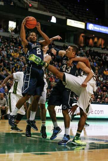 Penn State's D.J. Newbill, 2, and Ross Travis, 43, fight for a rebound against Siena defenders durin