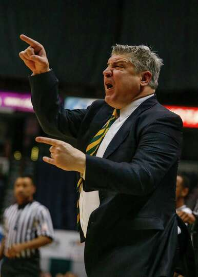 Siena's head coach Jimmy Patsos reacts to a foul called during the College Basketball Invitational q