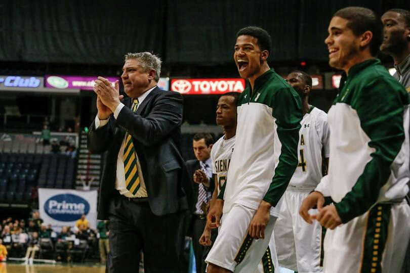 Siena's sideline celebrates as they take the lead against Penn State during the College Basketball I