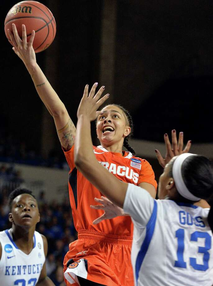 Syracuse' Rachel Coffet, left, puts up a shot over the defense of Kentucky's Bria Goss during the second half of a second-round game in the NCAA college basketball tournament in Lexington, Ky., Monday, March 24, 2014. Kentucky defeated Syracuse 64-59. (AP Photo/Timothy D. Easley) ORG XMIT: KYTE103 Photo: Timothy D. Easley / FR43398 AP
