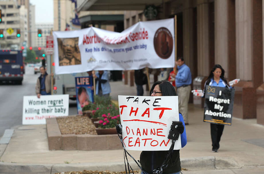 Rosanne Keinath (center) and other protesters gather outside a Planned Parenthood fundraiser luncheon at the Marriott Rivercenter. Actress Diane Keaton was the featured speaker. Photo: Jerry Lara / San Antonio Express-News / © 2014 San Antonio Express-News