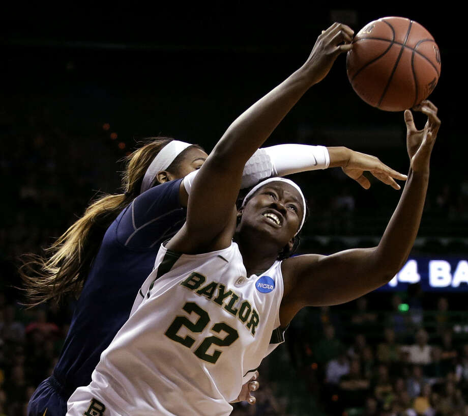 Baylor's Sune Agbuke grabs a rebound in front of California's Reshanda Gray. The Lady Bears led just 34-33 at halftime. Photo: Tony Gutierrez / Associated Press / AP