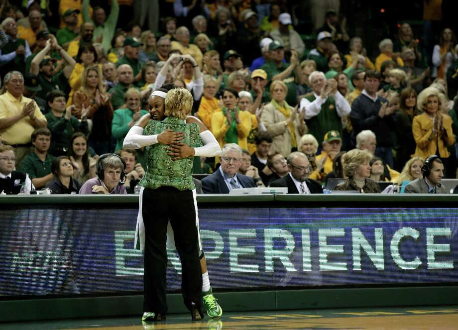 Baylor coach Kim Mulkey gives a big hug to Odyssey Sims, with fans applauding the senior guard as she leaves the court in the second half against California in what was her last game at the Ferrell Center. Photo: Tony Gutierrez, STF / AP