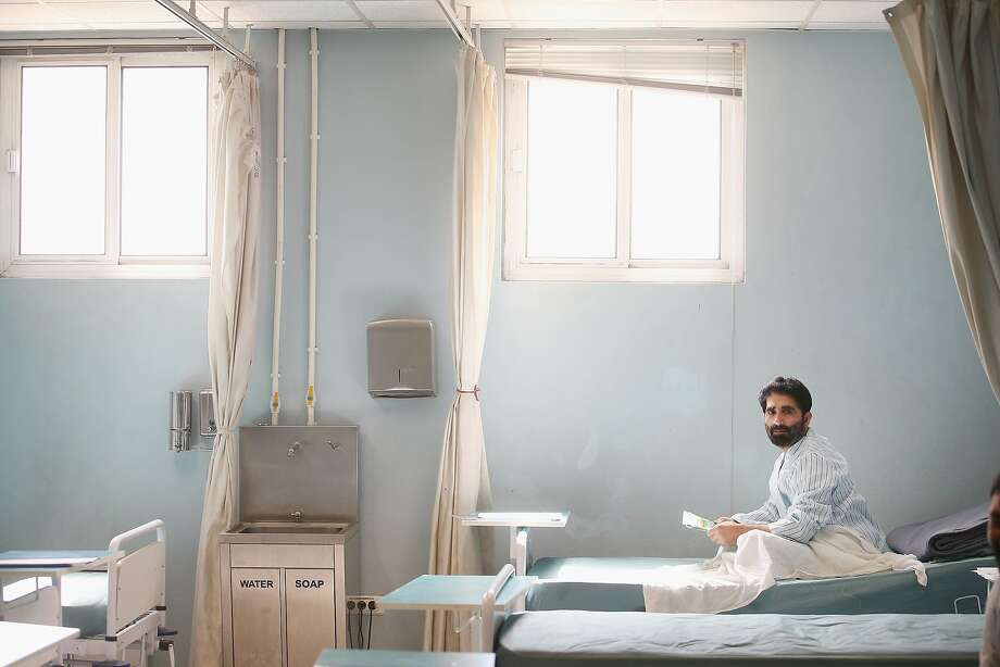 GARDEZ, AFGHANISTAN - MARCH 24: A patient sits in a recovery ward at the Paktia Regional Military Hospital at Forward Operating Base (FOB) Thunder on March 24, 2014 near Gardez, Afghanistan. The hospital, operated by the Afghan Army, treats wounded and sick soldiers and police from the Afghan National Security Forces (ANSF). Soldiers with the U.S. Army's 3rd Brigade Combat Team, 10th Mountain Division stationed at nearby FOB Lightning advise and assist the staff at the hospital.  (Photo by Scott Olson/Getty Images) *** BESTPIX *** Photo: Scott Olson, Getty Images