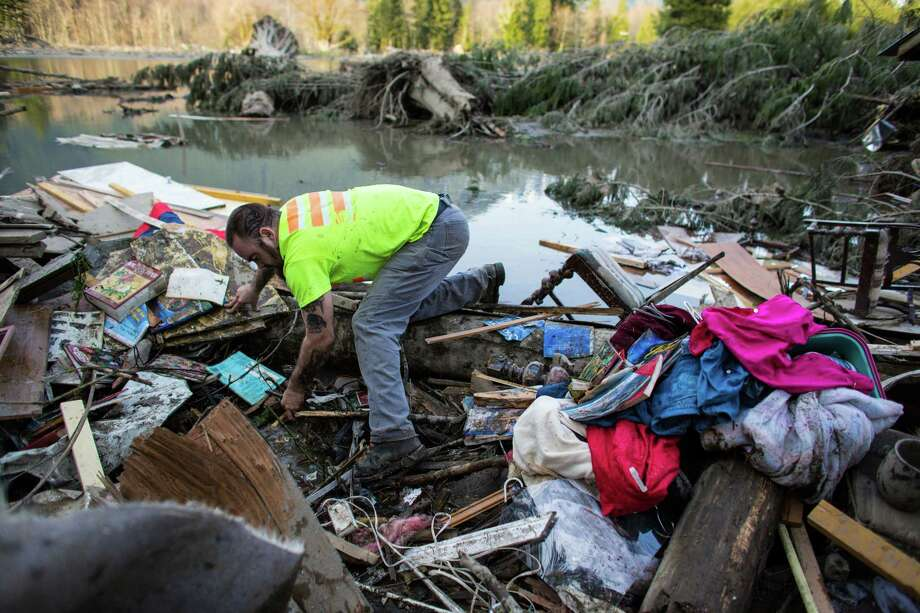 Iraq War veteran and local Little League coach Matt Pater, 32, searches the debris field near Oso. Pater hiked in past roadblocks to try and help. He hoped to help bring closure for any families missing loved ones. He said his experience in Iraq made him a good candidate to search for survivors and the trauma that may bring. In the wake of Saturday's mudslide on Highway 530 in Snohomish County, there have been 175 reports of missing people and the death toll has risen to 14.  Photo: JOSHUA TRUJILLO, SEATTLEPI.COM / SEATTLEPI.COM